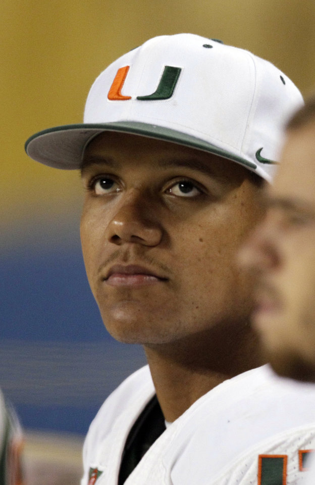 Photo -   Miami quarterback Stephen Morris looks up at the scoreboard late in the second half of an NCAA college football game against Notre Dame at Soldier Field, Saturday, Oct. 6, 2012, in Chicago. (AP Photo/Nam Y. Huh)