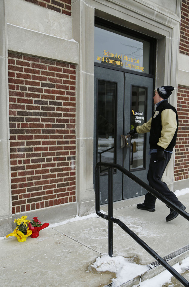 Photo - A student enters the Electrical Engineering building as it was reopened on Wednesday, Jan. 22, 2014, on the campus of Purdue University, in West Lafayette, Ind. The building had been closed since engineering student Andrew Boldt was shot and killed Tuesday at the Electrical Engineering building.   Cody Cousins, a student, has been charged in the shooting.     (AP Photo/Journal & Courier, John Terhune)
