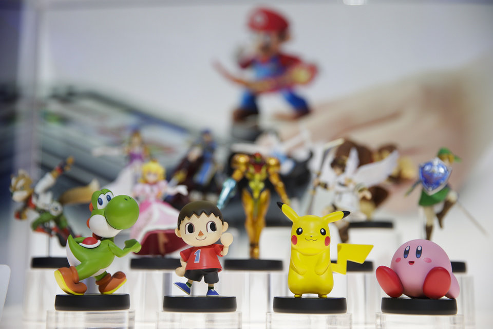 Photo - Amiibo characters for Wii U are on display at the Nintendo booth during the Electronic Entertainment Expo on Tuesday, June 10, 2014, in Los Angeles. (AP Photo/Jae C. Hong)