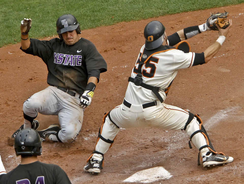 Photo - Kansas State's RJ Santigate (28) beats the throw to Oklahoma State catcher Jared Womack (55) during the Big 12 baseball tournament game between Oklahoma State University  and Kansas State University at the Chickasaw Bricktown Ballparkon Thursday, May 24, 2012, in Oklahoma City, Oklahoma. Photo by Chris Landsberger, The Oklahoman