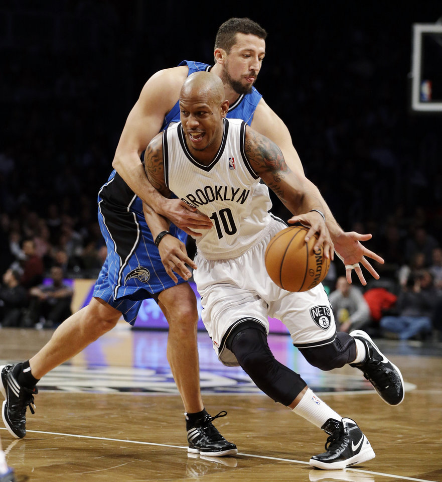 Brooklyn Nets forward Keith Bogans (10) drives to the basket as Orlando Magic forward Hedo Turkoglu, rear, defends in the first half of their NBA basketball game at Barclays Center, Monday, Jan. 28, 2013, in New York. (AP Photo/Kathy Willens)