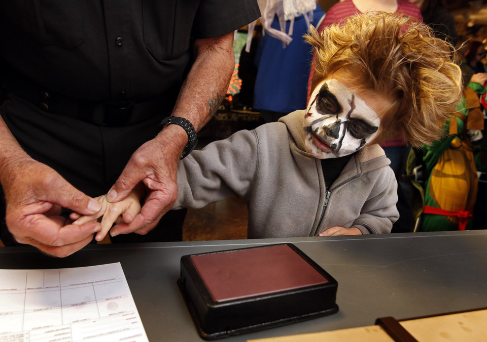 Orion VunCannon, 6, records his fingerprints courtesy of the Cleveland County Sheriff's office during trick or treating in the Discovery Cove Nature Center at Lake Thunderbird on Thursday, Oct. 25, 2012 in Norman, Okla.   Photo by Steve Sisney, The Oklahoman