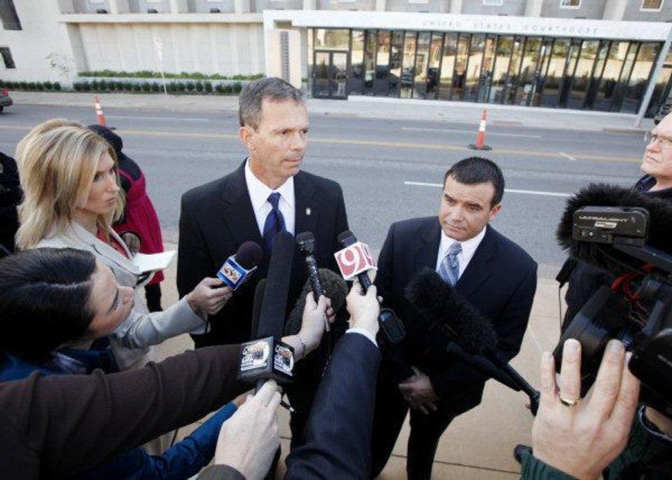 Photo - Oklahoma State Representative Rex Duncan, left and Oklahoma State Senator  Anthony Sykes talk to media outside the Federal Courthouse after U.S. Judge Vicki Miles-LaGrange handed down a temporary restraining order to block a state constitutional amendment that prohibits state courts from considering international or Islamic law when making rulings in Oklahoma. Oklahoma City, November  8 , 2010. Photo by Steve Gooch, The Oklahoman ORG XMIT: KOD ORG XMIT: OKC1011081244223621