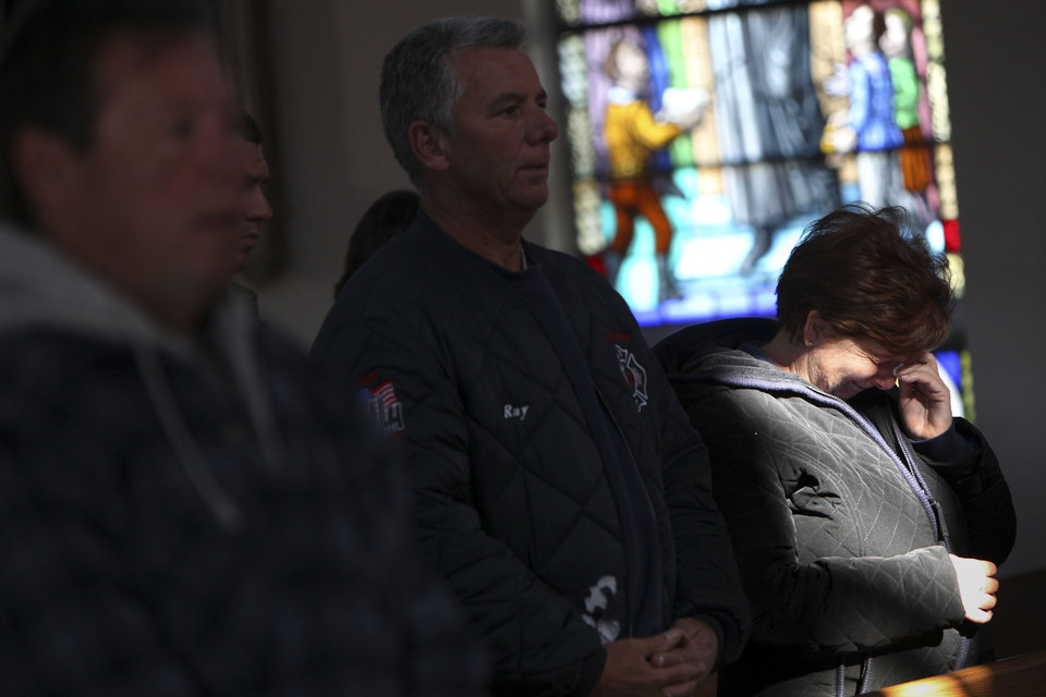 Photo -   Maryann Eger cries during Mass in the New Dorp neighborhood of Staten Island, N.Y., Sunday, Nov. 4, 2012, as the region copes in the aftermath of Superstorm Sandy. (AP Photo/Seth Wenig)
