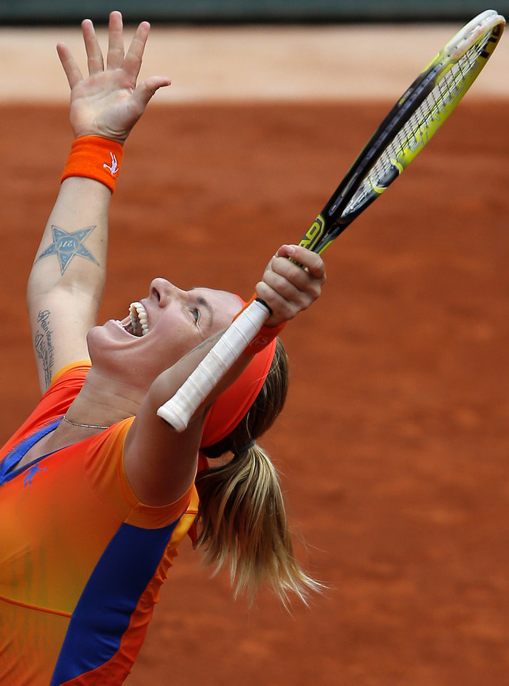 Photo - Russia's Svetlana Kuznetsova celebrates her victory over Petra Kvitova of the Czech Republic during the third round match of  the French Open tennis tournament at the Roland Garros stadium, in Paris, France, Saturday, May 31, 2014. Kuznetsova won 6-7, 6-1, 9-7. (AP Photo/Michel Spingler)