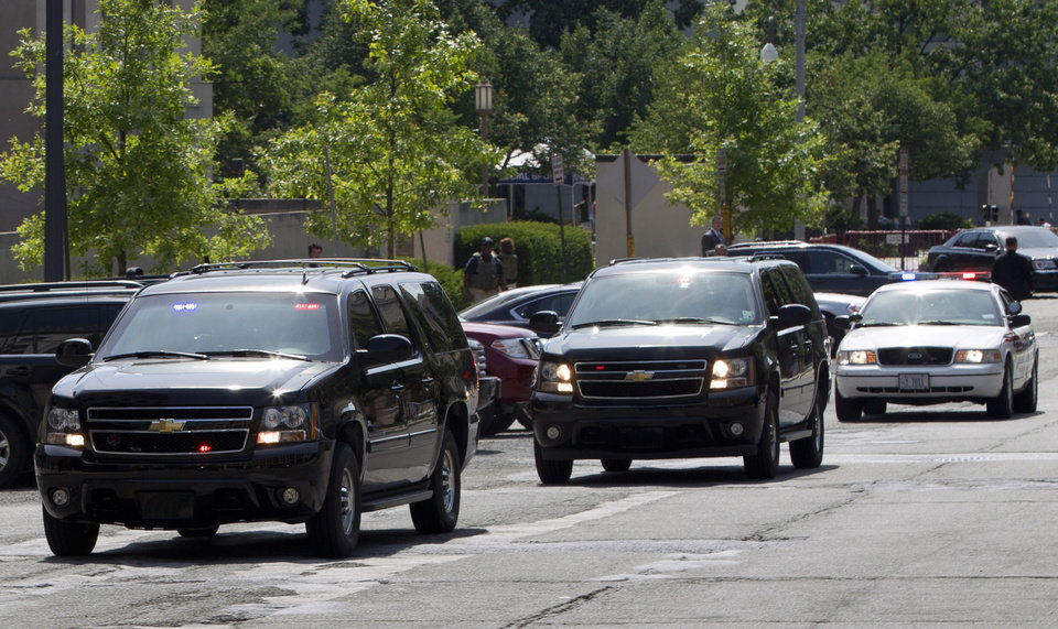 Photo - The motorcade transporting the Libyan militant Ahmed Abu Khattala, accused of masterminding the deadly Benghazi attack at the U.S. embassy, leaves the federal U.S. District Court in Washington Saturday, June 28, 2014, after Khattala pleaded not guilty to conspiracy at his first court appearance in the United States. (AP Photo/Jose Luis Magana)