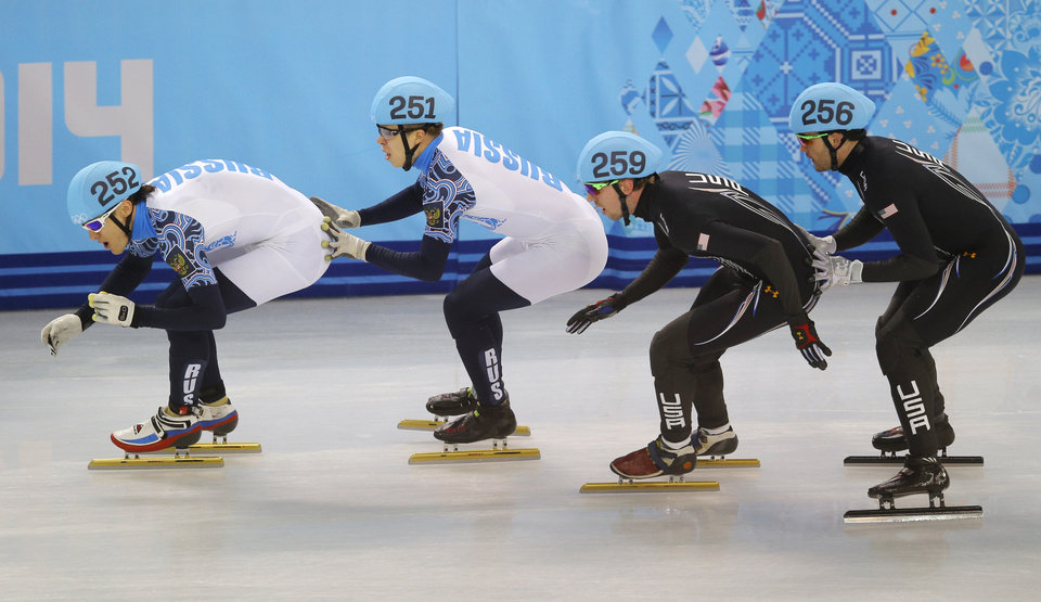 Photo - From left, Vladimir Grigorev of Russia, Semen Elistratov of Russia, Chris Creveling of the United States, Eduardo Alvarez of the United States at the Iceberg Skating Palace during the 2014 Winter Olympics, Friday, Feb. 21, 2014, in Sochi, Russia. (AP Photo/Vadim Ghirda)