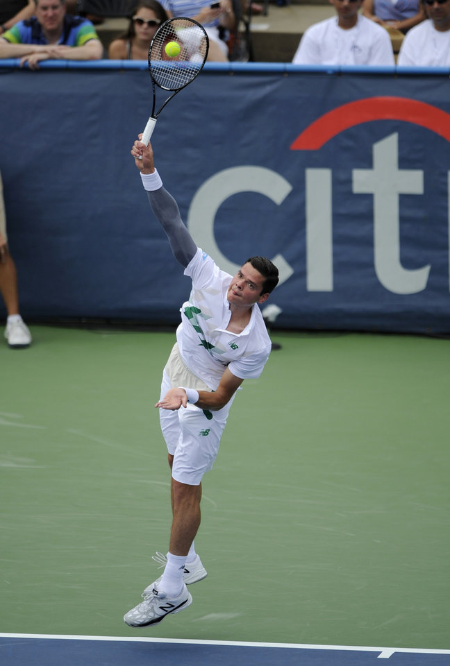 Photo - Milos Raonic, of Canada, serves to Donald Young during a match at the Citi Open tennis tournament, Saturday, Aug. 2, 2014, in Washington. (AP Photo/Nick Wass)