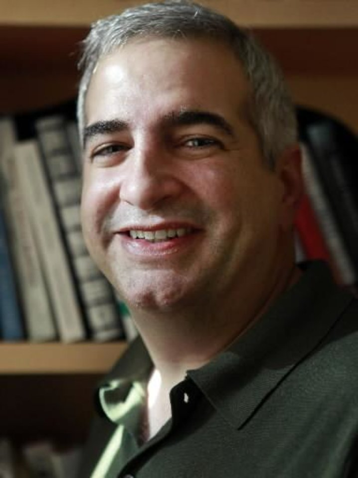 In this April 12, 2010 file photo, Anthony Shadid winner of the 2010 Pulitzer Prize for International Reporting with The Washington Post, poses for a portrait at the Watson Institute for International Studies on the campus of Brown University, in Providence, R.I. Shadid, now The New York Times' Beirut bureau chief, and three other Times journalists covering the fighting in Libya were reported missing Wednesday, March 16, 2011, and the newspaper held out hope that they were alive and in the custody of the Libyan government. (AP Photo/Steven Senne, File)