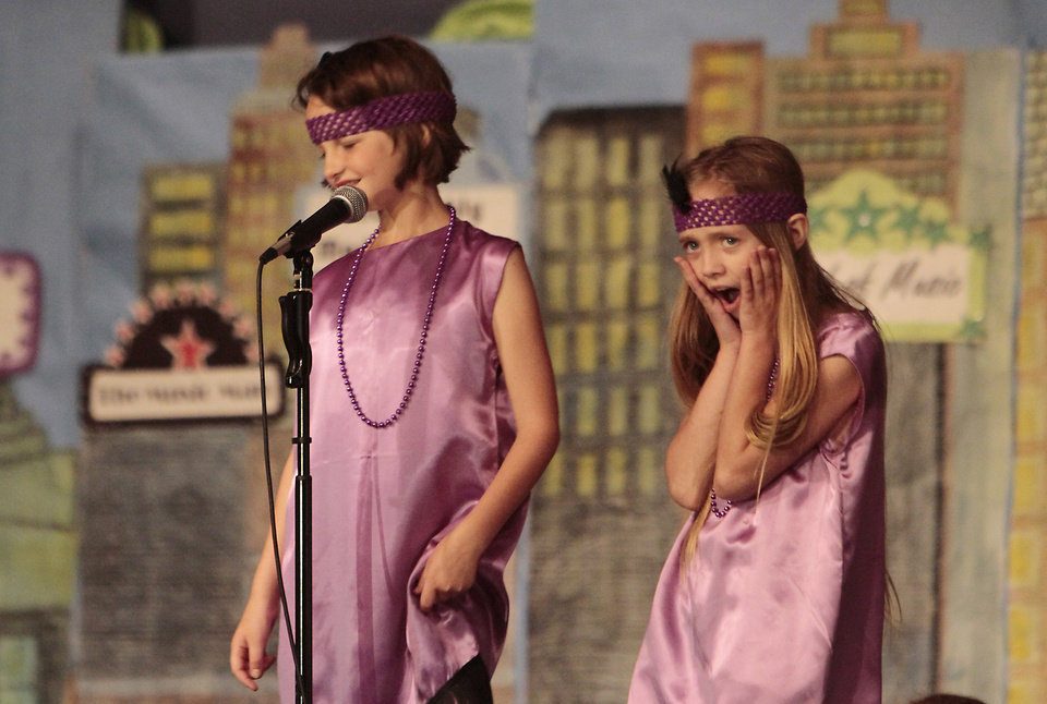 "Photo - Flappers Ella Brinkman and Soleil Hawley sing a song from ""Thoroughly Modern Millie."""