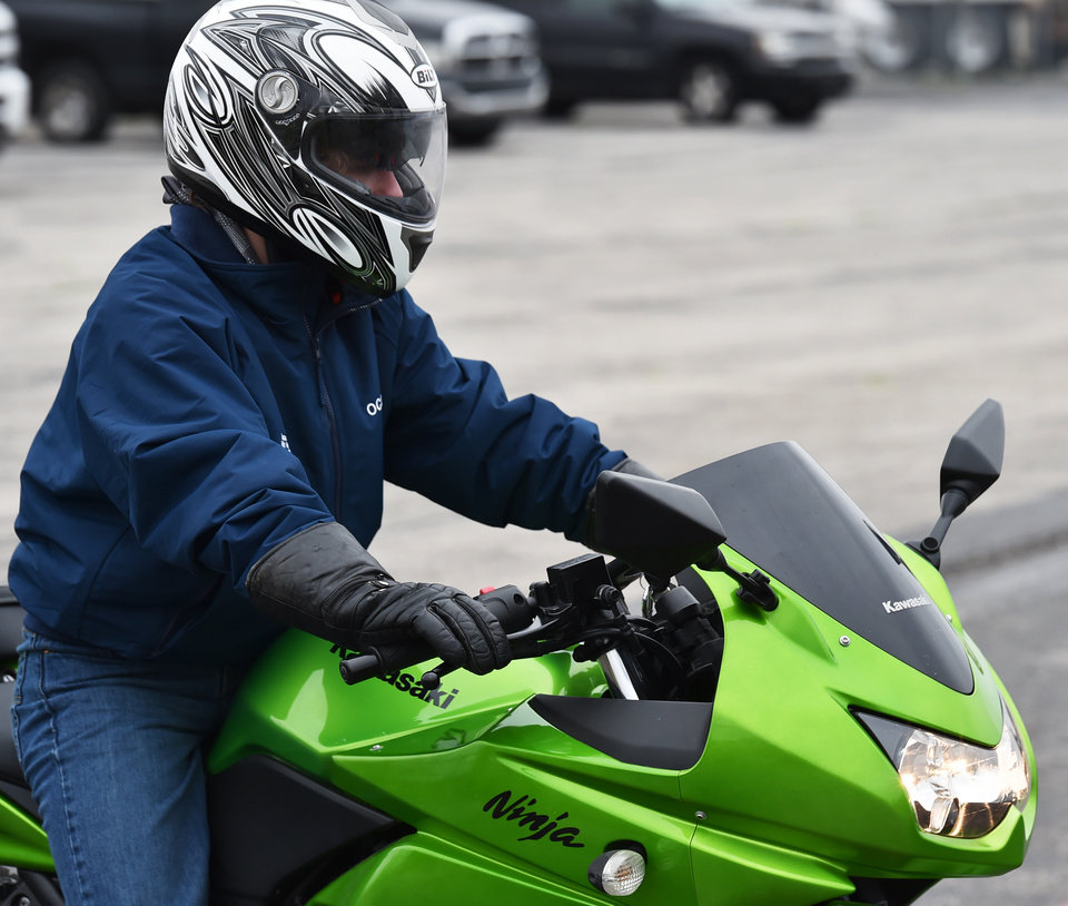 Photo -  Issac Moss drives his motorcycle during the Precision Driving School motorcycle training class in Norman. [Photo by Tyler Drabek, For The Oklahoman]
