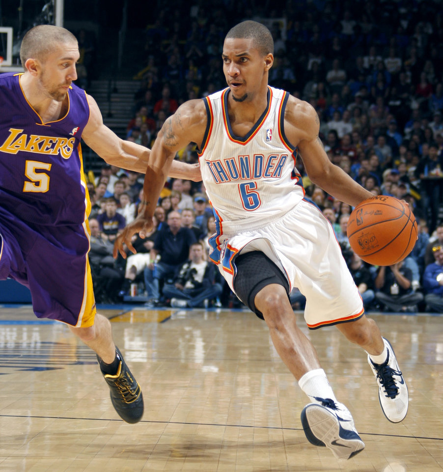 Photo - Oklahoma City's Thabo Sefolosha (2) tries to get by Lakers' Steve Blake (5) during the NBA basketball game between the Oklahoma City Thunder and the Los Angeles Lakers, Sunday, Feb. 27, 2011, at the Oklahoma City Arena.Photo by Sarah Phipps, The Oklahoman