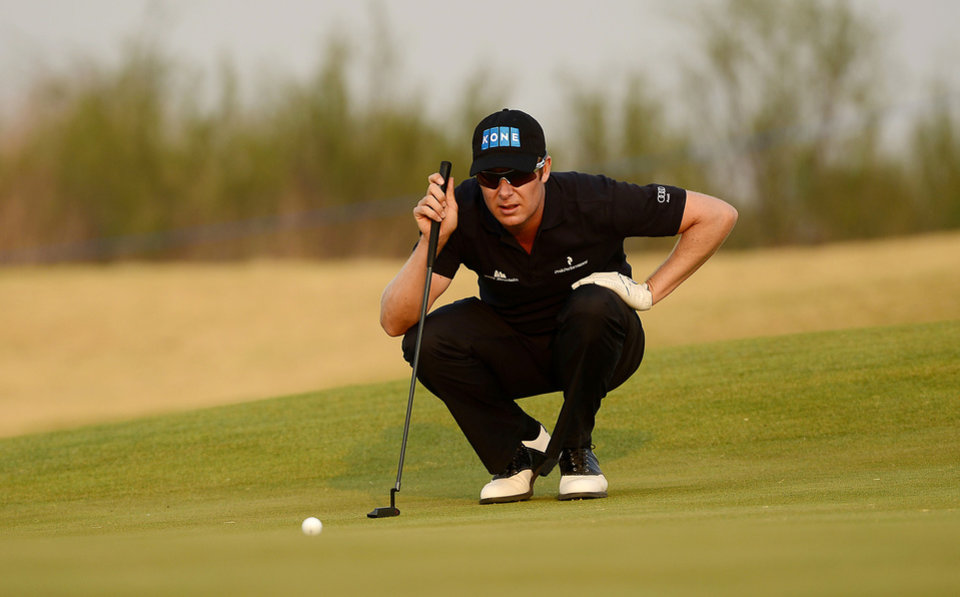 In this photo released by OneAsia, Mikko Ilonen of Finland lines up his putt during the second round of China Open golf tournament at Tianjin Binhai Lake Golf Club in Tianjin, China on Friday, May 3, 2013. (AP Photo/OneAsia, Paul Lakatos) NO LICENSING