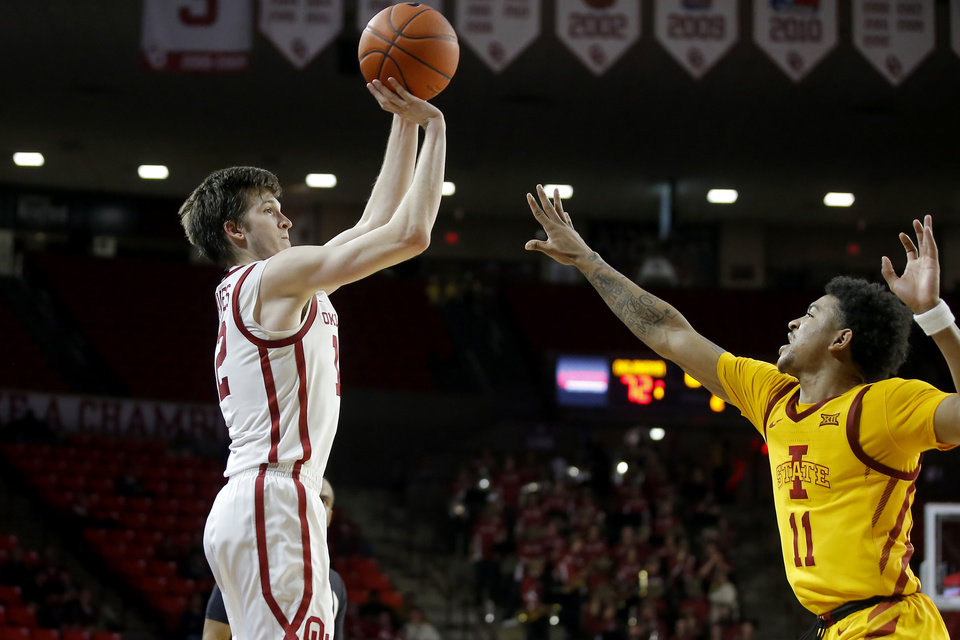 Photo - Oklahoma's Austin Reaves (12) shoots a 3-pointer over Iowa State's Prentiss Nixon (11) during an NCAA basketball game between the University of Oklahoma Sooners (OU) and the Iowa State Cyclones at the Lloyd Noble Center in Norman, Okla., Wednesday, Feb. 12, 2020. [Bryan Terry/The Oklahoman]