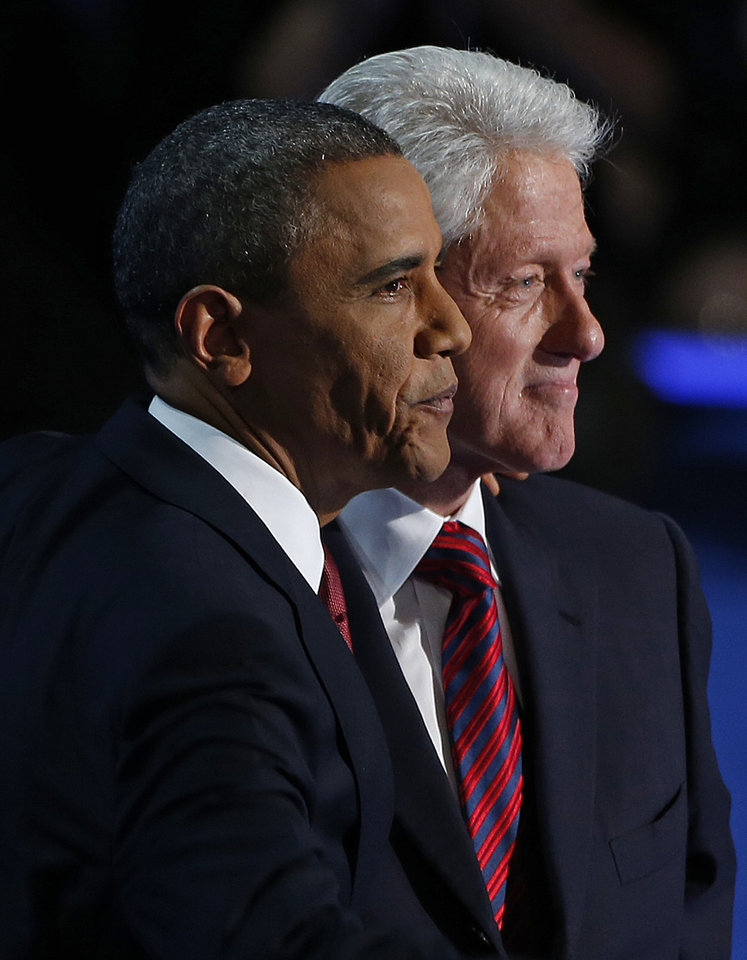 Photo -   President Barack Obama stands with Former President Bill Clinton after Clintons' address to the Democratic National Convention in Charlotte, N.C., on Wednesday, Sept. 5, 2012. (AP Photo/Carolyn Kaster)