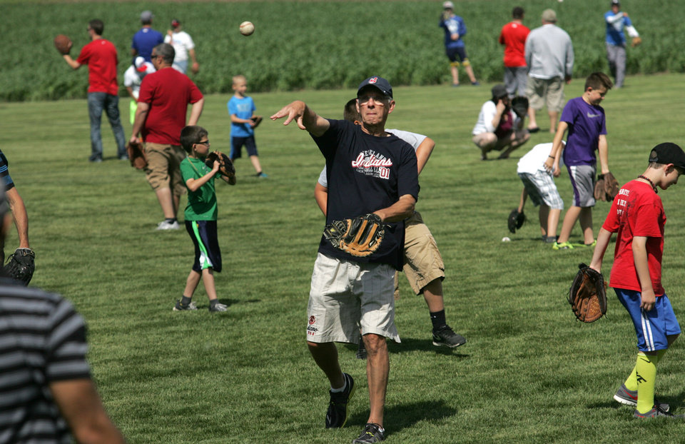 Photo - Tom Stahl, 66, of Dublin, Ohio, has a catch with his 32-year-old son, Josh Stahl of Portland, Ore., on Saturday, June 14, 2014,at the Field of Dreams 25th anniversary celebration, Saturday, June 14, 2014, on the Field of Dreams outside Dyersville, Iowa. (AP Photo/Waterloo Courier,Dennis Magee)