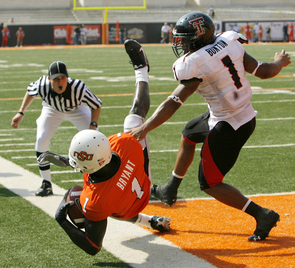 OSU's Dez Bryant (1) keeps one foot in bounds on a touchdown catch in front of Texas Tech's Marcus Bunton (1) in the second quarter of the college football game between the Oklahoma State University Cowboys (OSU) and the Texas Tech University Red Raiders (TTU) at Boone Pickens Stadium in Stillwater, Okla., on Saturday, Sept. 22, 2007. By NATE BILLINGS, The Oklahoman