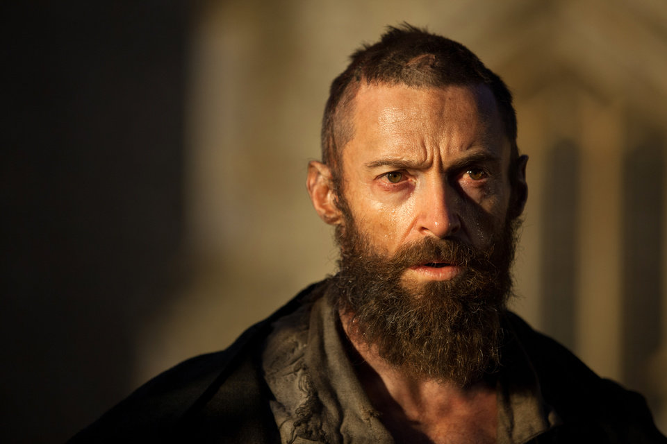 "FILE - This publicity film image released by Universal Pictures shows Hugh Jackman as Jean Valjean in a scene from ""Les Miserables."" The film is nominated for an Academy Award in the  Makeup and Hairstyling category. The 85th Academy Awards air live on ABC on Sunday, Feb. 24, 2013. (AP Photo/Universal Pictures, Laurie Sparham, File)"