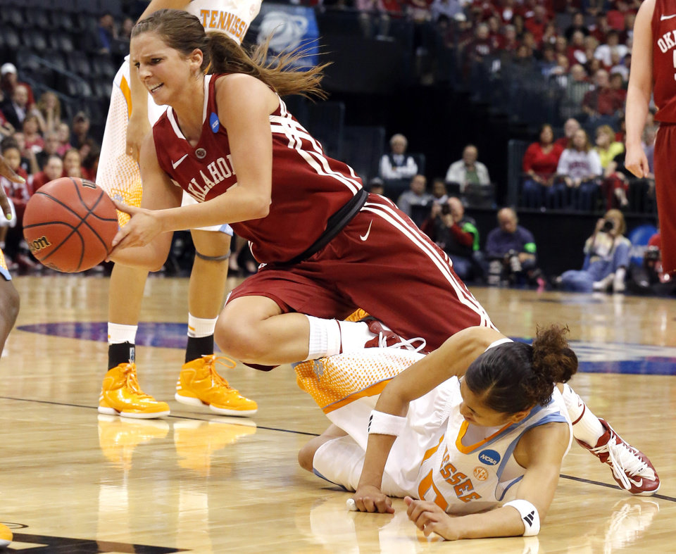 Photo - Oklahoma's Morgan Hook (10) falls after running in to Tennessee's Meighan Simmons (10) during college basketball game between the University of Oklahoma and the University of Tennessee at the  Oklahoma City Regional for the NCAA women's college basketball tournament at Chesapeake Energy Arena in Oklahoma City, Sunday, March 31, 2013. Photo by Sarah Phipps, The Oklahoman
