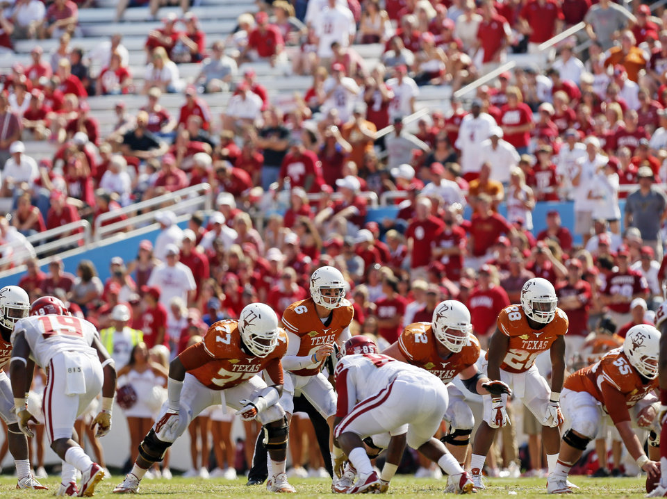UT's Case McCoy (6) and the Texas offense prepare to run a play as the OU crowd begins to thin out in the fourth quarter during the Red River Rivalry college football game between the University of Oklahoma Sooners and the University of Texas Longhorns at the Cotton Bowl Stadium in Dallas, Saturday, Oct. 12, 2013. UT won, 36-20. Photo by Nate Billings, The Oklahoman