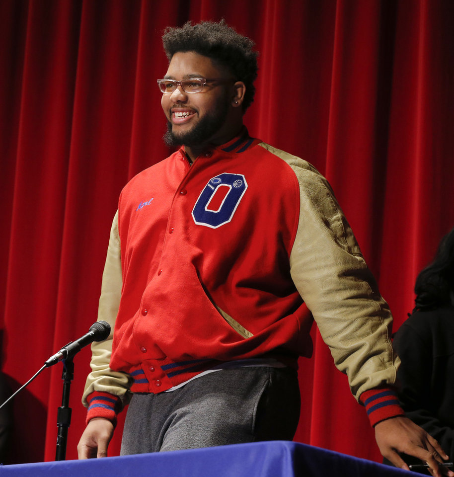 Photo - Nigel Brannon smiles as he starts to sit down before announcing that he will play football for Memphis during an assembly for National Signing Day at John Marshall High School in Oklahoma City, Wednesday, Feb. 7, 2018. Photo by Nate Billings, The Oklahoman