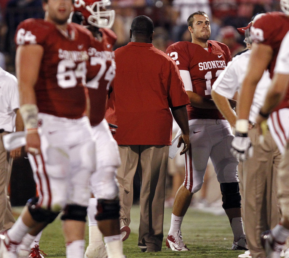 Oklahoma\'s Landry Jones (12) reacts as he walks off the field after throwing an interception during the college football game between the University of Oklahoma Sooners (OU) and the Kansas State University Wildcats (KSU) at the Gaylord Family-Memorial Stadium on Saturday, Sept. 22, 2012, in Norman, Okla. Photo by Chris Landsberger, The Oklahoman