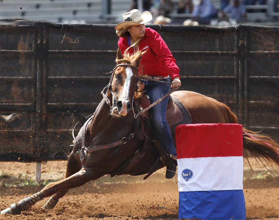 Morgan Hoover of Chandler, Okla., and her horse clear the second barrel on the course during the second go-round of the International Finals Youth Rodeo at the Heart of Oklahoma Exposition Arena in Shawnee, Okla., on Monday, July, 9, 2012.  Tuesday, July 3, 2012.  Photo by Jim Beckel, The Oklahoman