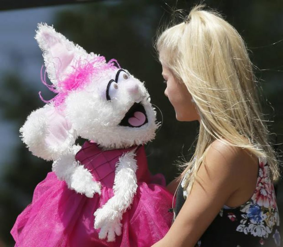 Photo - Darci Lynne Farmer, a 12-year-old ventriloquist from the Oklahoma City area, performs during Allied Arts' Brackets for Good Championship Celebration in Automobile Alley in Oklahoma City, Wednesday, June 28, 2017. Photo by Nate Billings, The Oklahoman