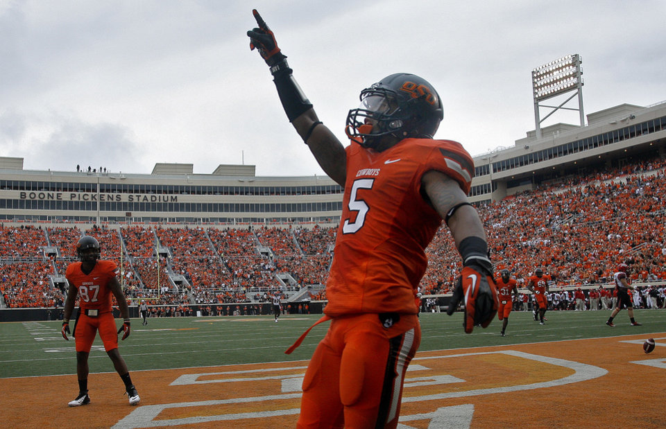 Photo - Oklahoma State's Josh Stewart (5) celebrates a touchdown during a college football game between Oklahoma State University (OSU) and the University of Louisiana-Lafayette (ULL) at Boone Pickens Stadium in Stillwater, Okla., Saturday, Sept. 15, 2012. Photo by Sarah Phipps, The Oklahoman