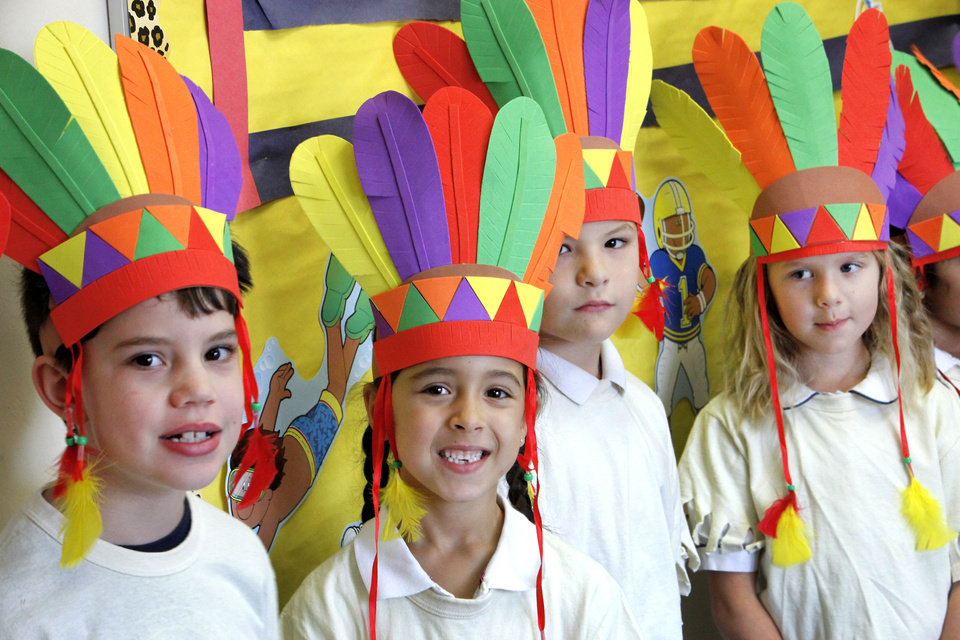 First-graders Brogan Holt, Alya Bakir, Issac Johnson and Lakein Ruble wear colorful headdresses for the Thanksgiving pageant at St. Mary's Episcopal School. PHOTOS BY DAVID MCDANIEL, THE OKLAHOMAN