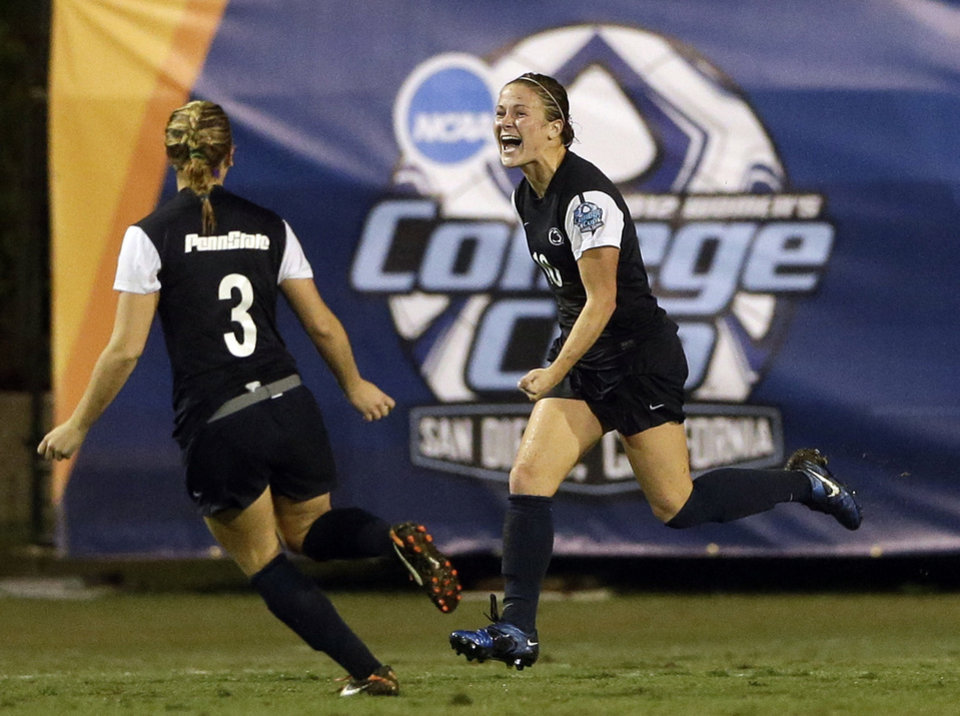 Photo - Penn State's Christine Nairn, right, celebrates with Emily Hurd after scoring the winning goal in overtime against Florida State in an NCAA women's college soccer tournament semifinal, Friday, Nov. 30, 2012, in San Diego. (AP Photo/Gregory Bull)