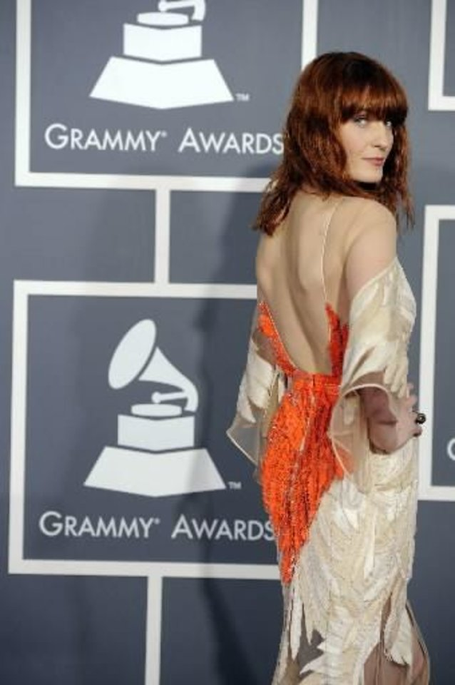 Florence Welch of Florence + The Machine poses at the Grammy Awards. She will perform on tonight's Oscars, too. (Associated Press file photo)