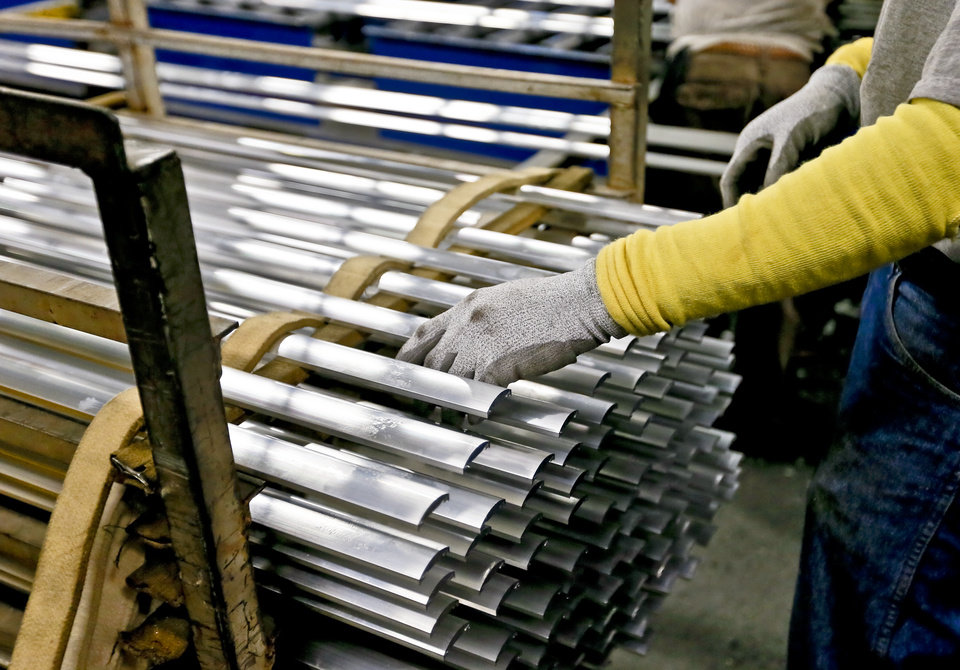 A crew member sorts aluminum strips to be used in production of items at the MD Building Products plant on Wednesday, Jan. 2, 2013, in Oklahoma City, Okla. Photo by Chris Landsberger, The Oklahoman