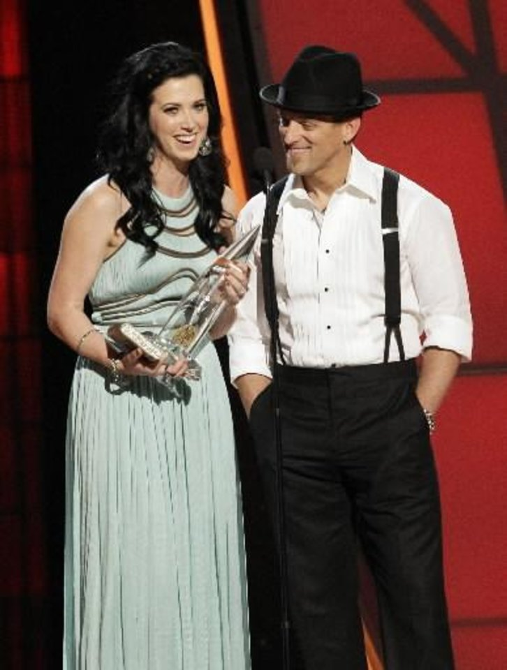 Photo -  Thompson Square accepts the vocal duo of the year award at the CMA Awards Thursday night in Nashville, Tenn. (AP photos)