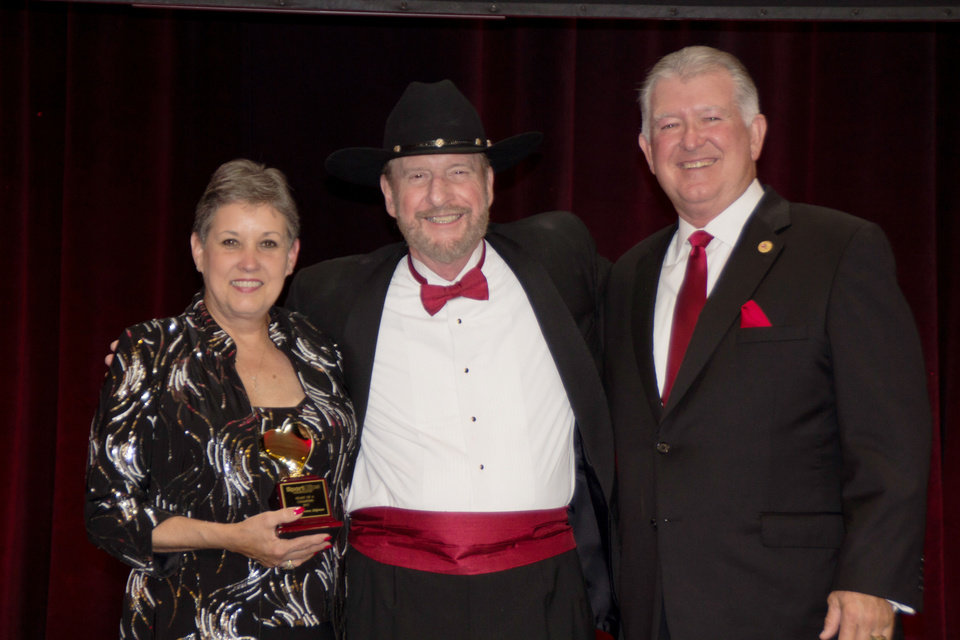 Donna and Larry Shipman with Sport Clips Founder and Chief Executive Officer Gordon Logan (center.) <strong> - PROVIDED</strong>