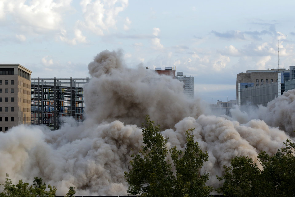Photo - Demolition crews implode the Hotel Black to make room for a new office tower in downtown Oklahoma City, Sunday September, 13 2015. Photo By Steve Gooch, The Oklahoman