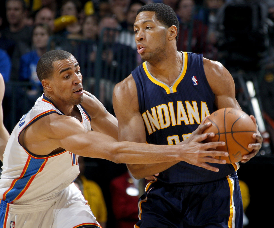 Photo - Oklahoma City's Thabo Sefolosha (2) defends Indiana's Danny Granger (33)during the NBA basketball game between the Oklahoma City Thunder and the Indiana Pacers at the Oklahoma City Arena, Wednesday, March 2, 2011. Photo by Bryan Terry, The Oklahoman