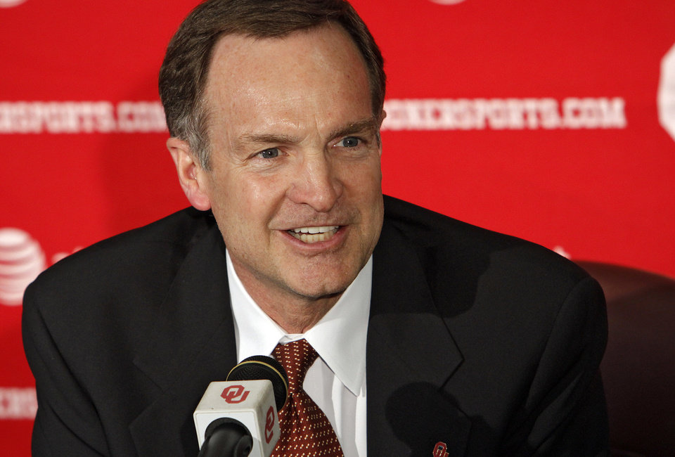 Photo - Lon Kruger speaks to the media after being introduced as the new University of Oklahoma men's basketball coach on Monday, April 4, 2011, in Norman, Okla.