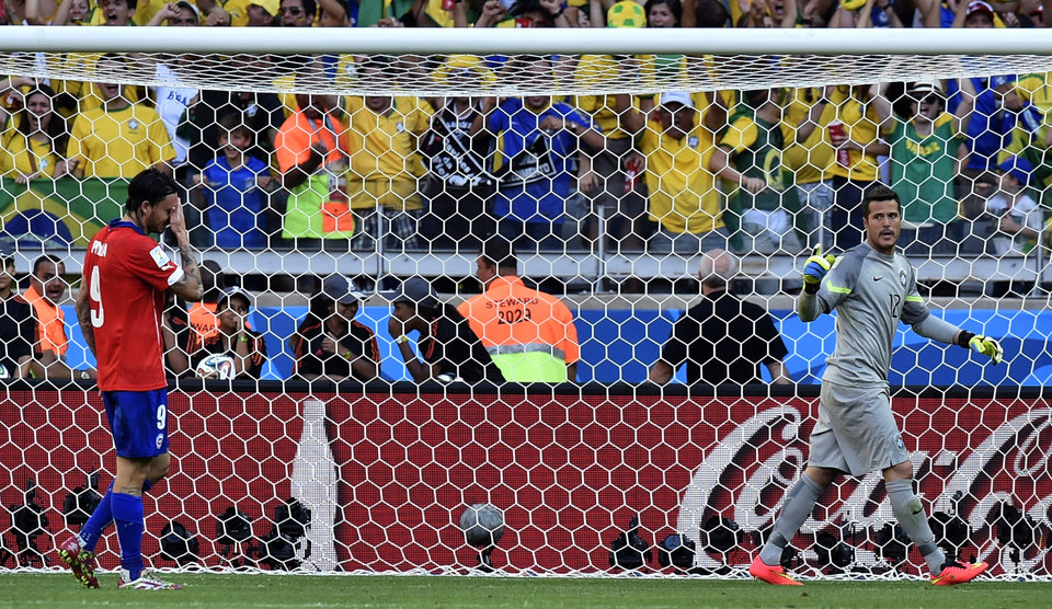 Photo - Chile's Mauricio Pinilla reacts after missing a penalty in a shoot out at the end of the World Cup round of 16 soccer match between Brazil and Chile at the Mineirao Stadium in Belo Horizonte, Brazil, Saturday, June 28, 2014. (AP Photo/Martin Meissner)