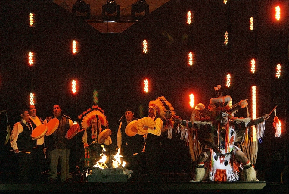 Photo - Native American performers put on a show during the Centennial Spectacular to celebrate the 100th birthday of the State of Oklahoma at the Ford Center on Friday, Nov. 16, 2007, in Oklahoma City, Okla. Photo By CHRIS LANDSBERGER, The Oklahoman