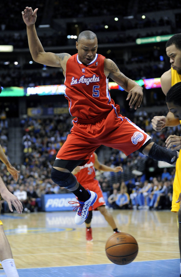 Los Angeles Clippers forward Caron Butler (5) goes airborne as he loses control of the ball during the first quarter of an NBA basketball game against the Denver Nuggets, Tuesday, Jan. 1, 2013, in Denver. (AP Photo/Jack Dempsey)