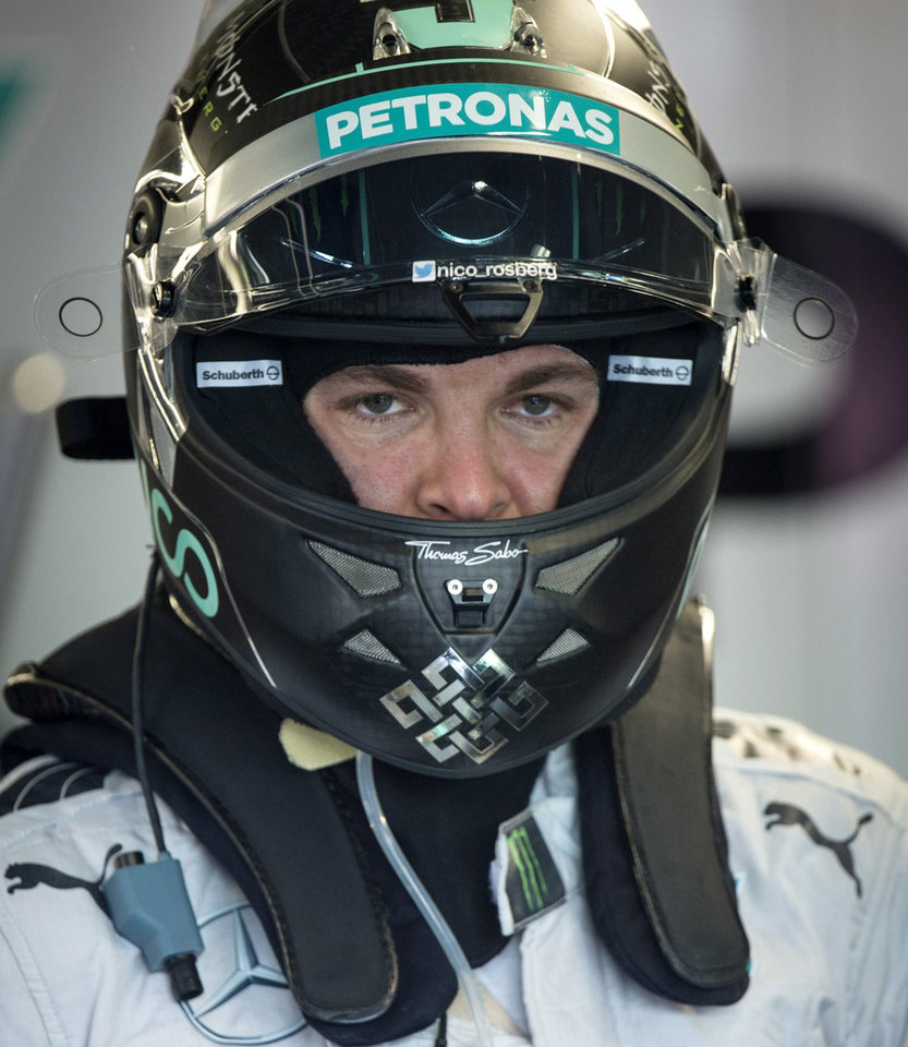 Photo - Mercedes driver Nico Rosberg from Germany gets ready to hit the track for the first practice session at the Canadian Grand Prix Friday, June 6, 2014, in Montreal. (AP Photo/The Canadian Press, Paul Chiasson)