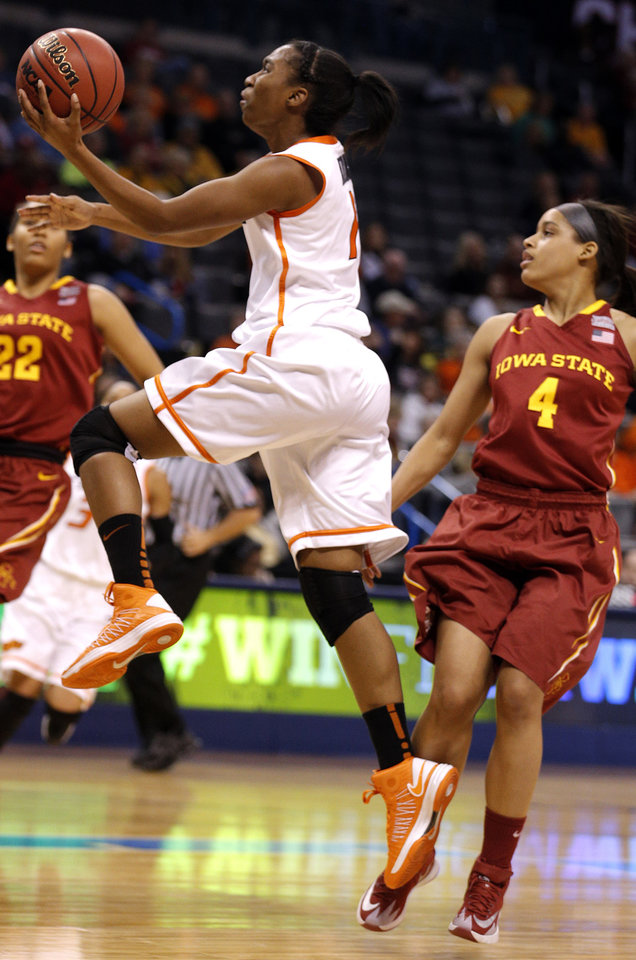 Photo - Oklahoma State's Brittany Atkins (1) goes up for a lay up in front of Iowa State's Nikki Moody (4) during the Women's Big 12 basketball tournament at  Chesapeake Energy Arena  in Oklahoma City, Okla., Saturday, March 8, 2014. Photo by Sarah Phipps, The Oklahoman