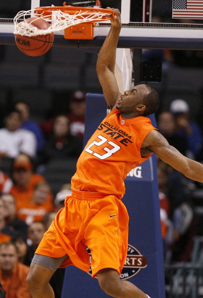 Photo - OSU's James Anderson (23) dunks the ball during the first half of the college basketball game between Oklahoma State University (OSU) and La Salle University in the All College Basketball Classic at the Ford Center on Monday, Dec. 21, 2009, in Oklahoma City, Okla.   Photo by Chris Landsberger, The Oklahoman ORG XMIT: KOD