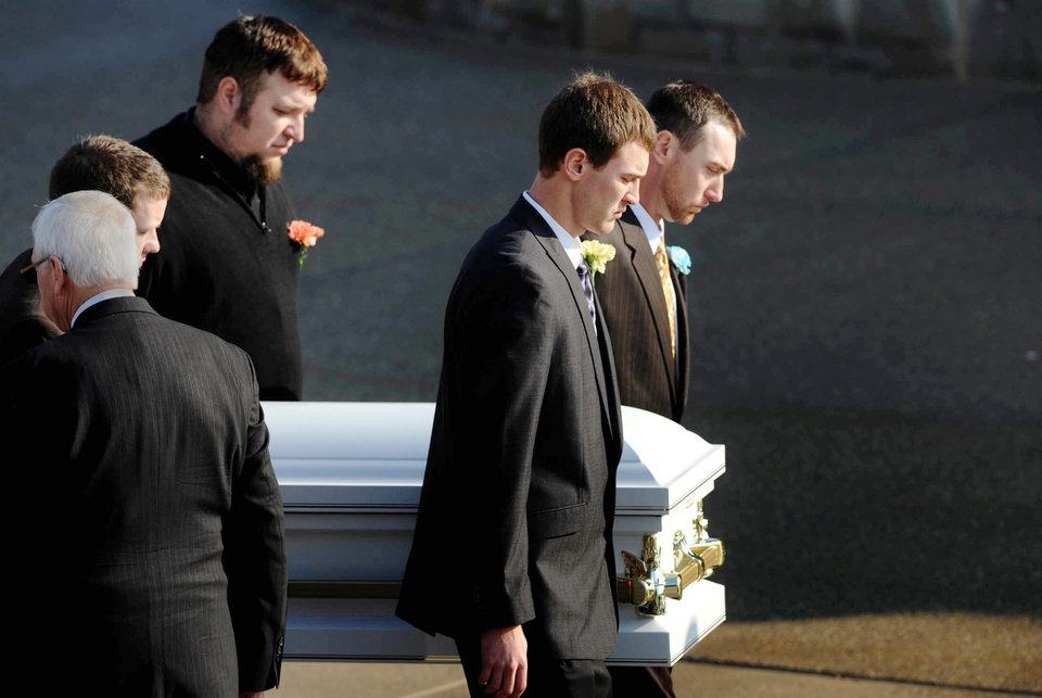 Pallbearers bring the casket of 2-year-old Maddox Derkosh into Saint Bernard Church in Mount Lebanon for funeral services on Friday, Nov. 9, 2012. Derkosh was killed Sunday after he fell from a wooden railing overlooking the painted dogs exhibit at the Pittsburgh Zoo and PPG Aquarium and bled to death after being mauled by the dogs. The parents of Maddox Derkosh requested toy truck donated instead of flowers because their son liked to play with trucks and share them with friends. More than 3,000 have been donated, and the William Slater II funeral home says it will continue accepting the trucks even after the boy's funeral Friday morning. The family intends to donate the trucks to a charity that will distribute them to needy children on Christmas. (AP Photo/Pittsburgh Post-Gazette, Michael Henninger)