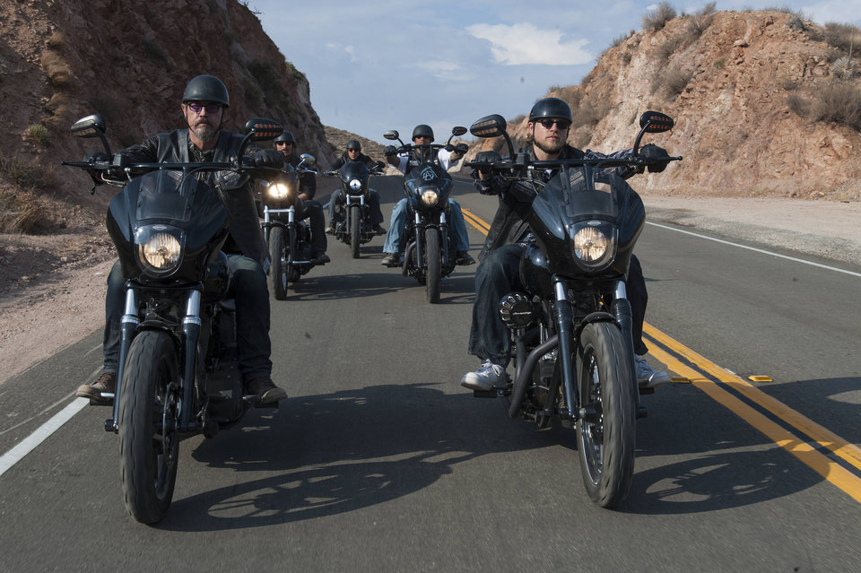 Photo - This image released by FX shows Tommy Flanagan as Filip 'Chibs' Telford, left, and Charlie Hunnam as Jackson