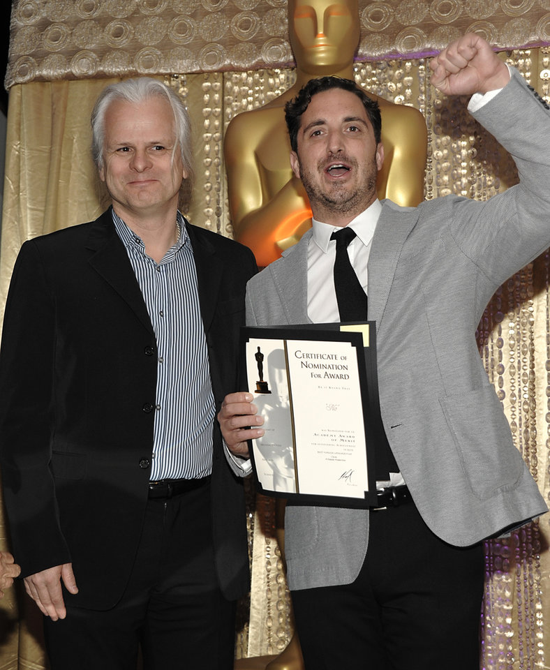 Photo - Cinematographer Claudio Miranda, left, and director Pablo Larraín pose together during the The Oscars Foreign Language Film Award Directors Reception at The Academy of Motion Picture Arts and Sciences in Beverly Hills, Calif. on Friday, Feb. 22, 2013. Larraín's feature film