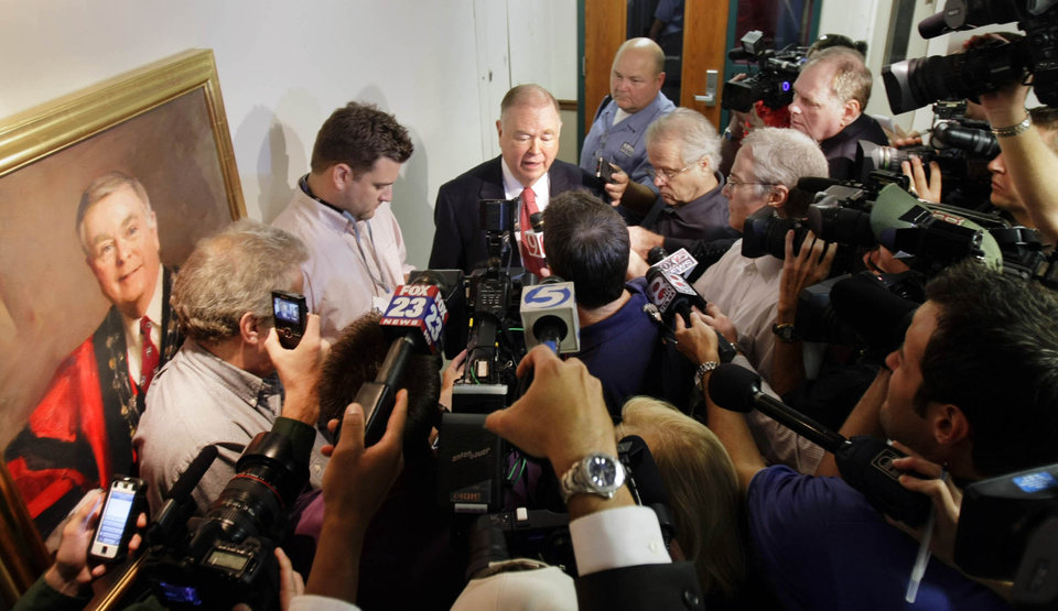 Standing near his portrait, University of Oklahoma president David Boren is surrounded by reporters and cameras on Monday, Sept. 19, 2011, in Tulsa, Okla. Texas and Oklahoma cleared the way Monday for their departure from the Big 12 Conference, with regents at both powerhouse schools giving their presidents the authority to find a new home. (AP Photo/Tulsa World, Michael Wyke) ORG XMIT: OKTUL106