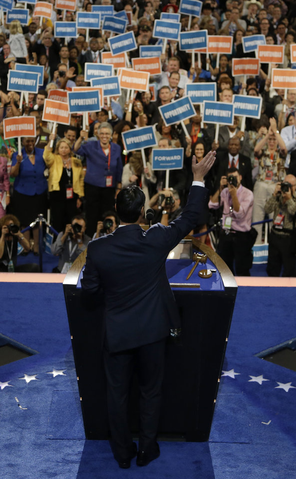 Photo - San Antonio Mayor Julian Castro waves to delegates after his speech at the Democratic National Convention in Charlotte, N.C., on Tuesday, Sept. 4, 2012. (AP Photo/Charlie Neibergall)  ORG XMIT: DNC517