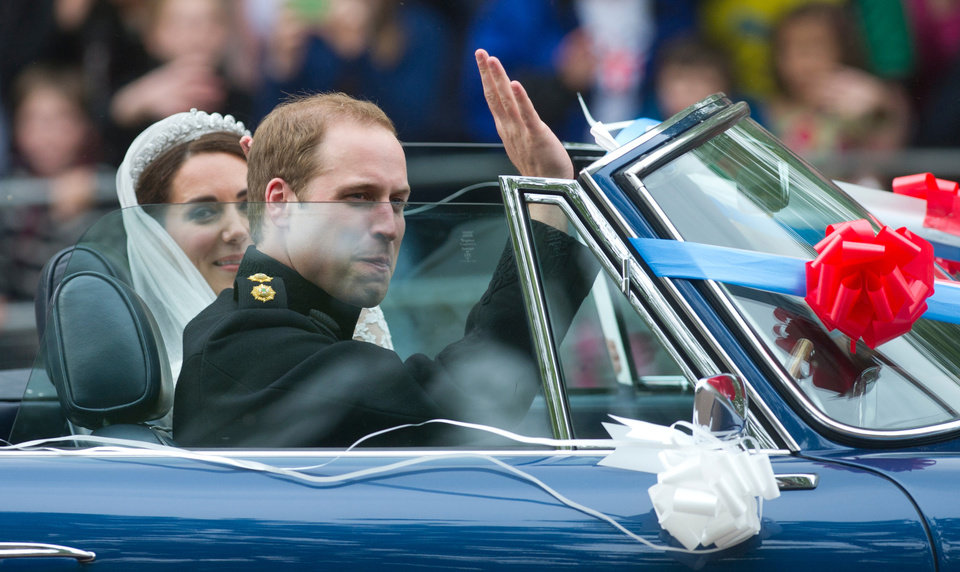 Photo - Britain's Prince William drives his wife Kate, Duchess of Cambridge, away from Buckingham Palace in a vintage Aston Martin Volante convertible after their wedding at London's Westminster Abbey, Friday, April, 29, 2011. (AP Photo/Bogdan Maran) ORG XMIT: RWBM127